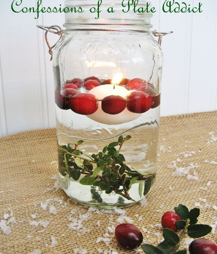 fun and easy christmas mason jar candles, christmas decorations, seasonal holiday decor, For this version you will need a floating candle fresh cranberries and some sprigs of boxwood I tied the boxwood to a nut to hold it at the bottom of the Mason jar Then simply add water a floating candle and fresh cranberries