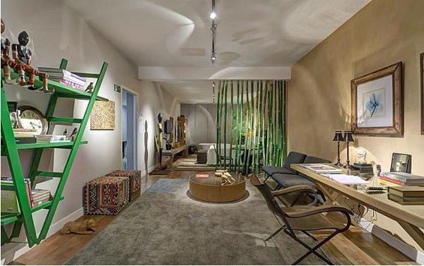 Green is a soothing colour. Create a fascinating living room décor with an upside-down wooden ladder and bamboo sticks.