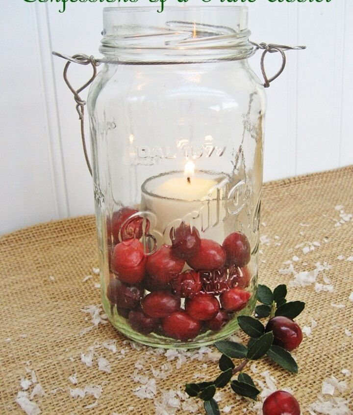 fun and easy christmas mason jar candles, christmas decorations, seasonal holiday decor, In this festive but simple version just place a votive candle and glass votive holder inside a Mason jar and surround the outer portion with fresh cranberries
