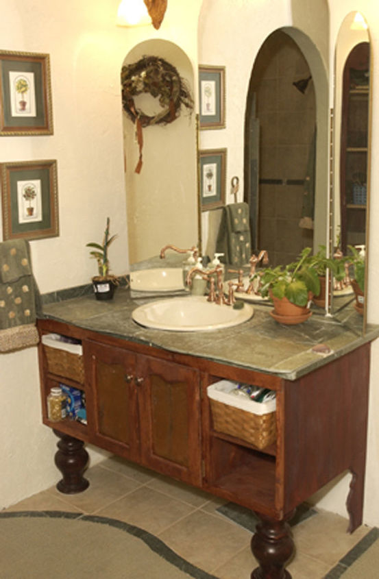 My hubby built this little vanity and I topped it off with a carved green slate tile.