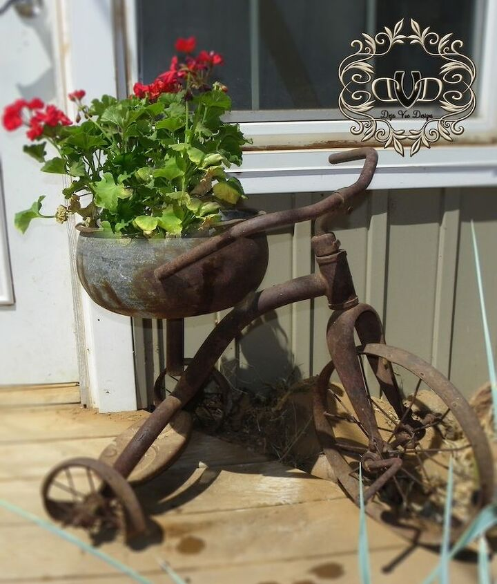 Here I took my husband's childhood tricycle that the bus hit and knocked the seat off of.  By replacing the seat with a metal bowl...I found the opportunity to bring this baby to the forefront each season.