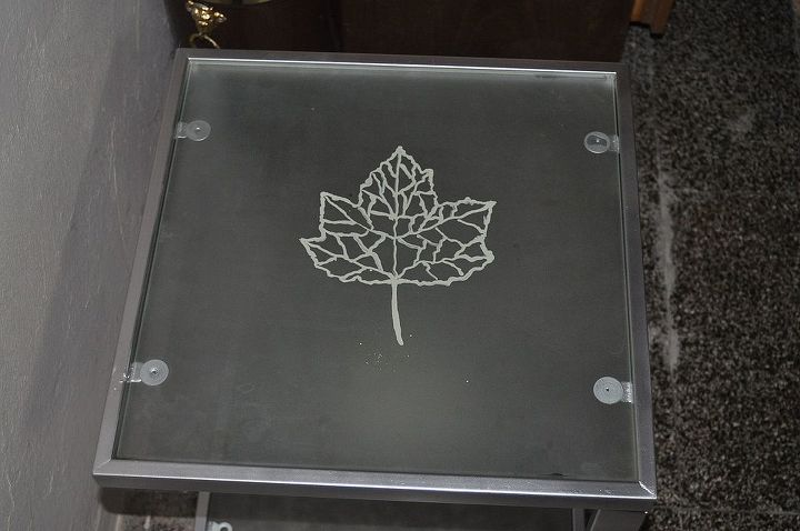 old rusty table that i found in the dumpster. i sanded it and painted the feet and the glass i painted with maple leaves