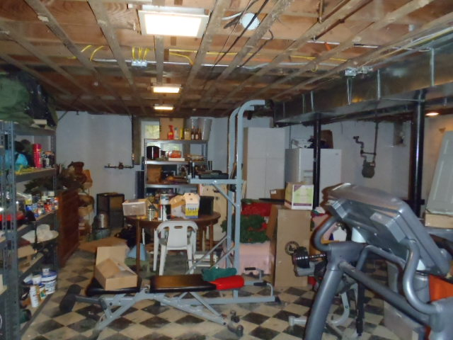 Before photo of the unfinished basement.