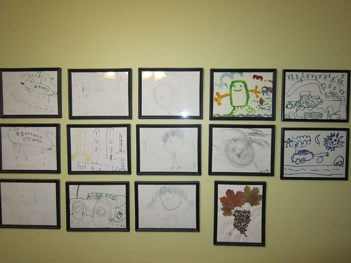 Pencil drawings framed in dollar store diploma frames. The kids were 4 and 5 years old when they made these and I put them up on the wall in my office.