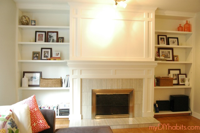 Here is how I transformed my old brick fireplace into a traditional and custom statement piece!  LOVE IT!