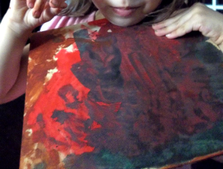 This was her first layer of a third painting.  She asked for red, green, and brown. I'll see if she picks this one up tomorrow and asks for another color; if not, she'll probably move on to a new painting.