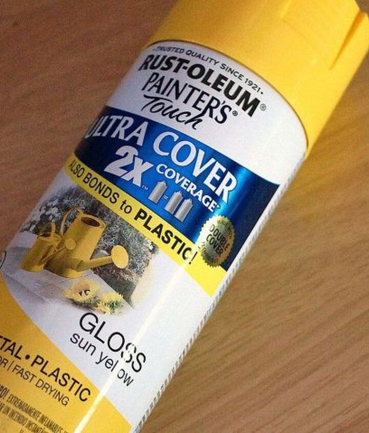 After taping the lamp off, I sprayed it yellow.  No primer needed this time!