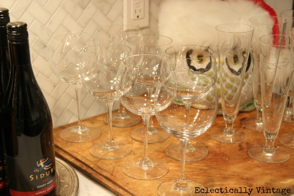 2) Make a festive cocktail and set out glasses and wine and water on a tray for an instant makeshift bar