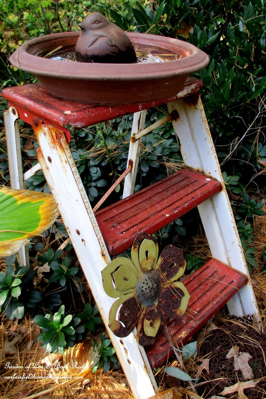 old metal step ladder with a clay saucer and a cast iron bird equals a 5 minute birdbath