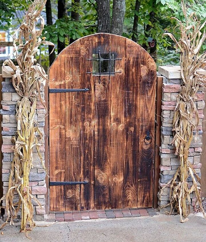 The Husband built this rustic garden gate and stacked stone pillars to welcome everyone into the backyard space...