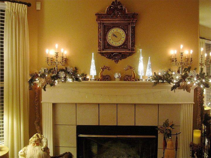 christmas mantel, christmas decorations, seasonal holiday decor, Candelabras gold deer mercury glass greenery crystals and lights make the mantel glisten