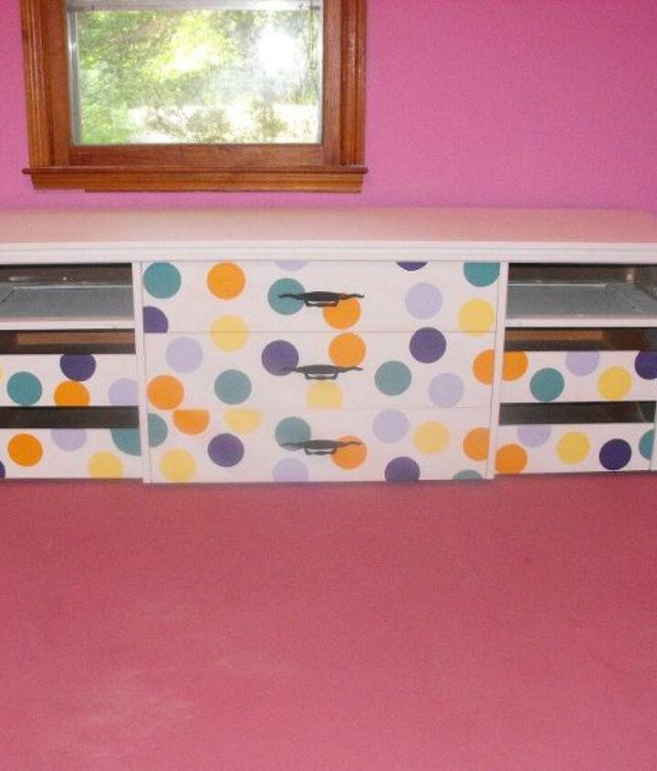 I re-purposed a vintage dresser that needed a LOT of love into a toy box for her.