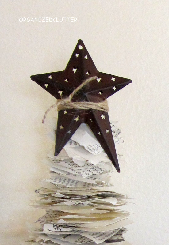 When finished I cut the sharp point off of the top of my twig and tied a metal star to the top with jute.