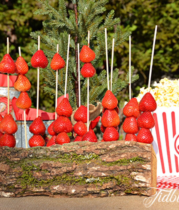 Strawberries on a log!  Just drill holes into the log and insert the skewers.