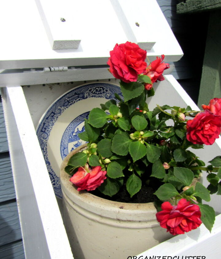 Added a a plate and an old crock planted with a double impatiens.