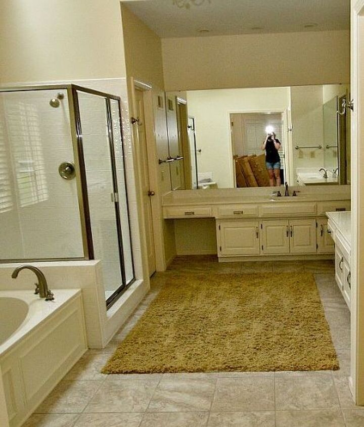 BEFORE photo: Too short vanities, old broken tub, dated shower enclosure, mold under tile.