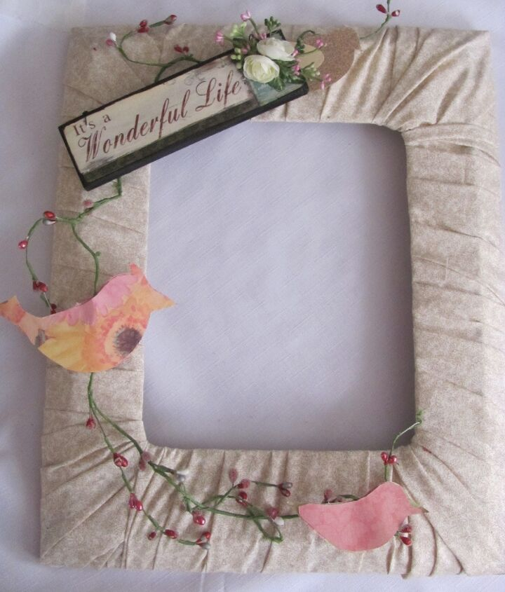 This is another one I did. I had my table full of stuff and trying things out on all the frames that I had wrapped with fabric. :)