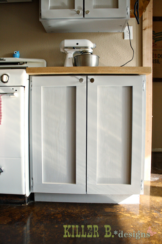 """30"""" cabinet with double doors and no drawers for ample space to store pots and pans"""