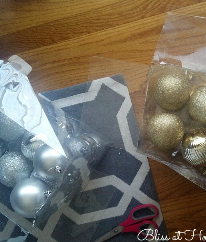 Select items to go inside the glass. I used shatterproof ornaments in metallic colors. These are inexpensive and usually come in big quanities.
