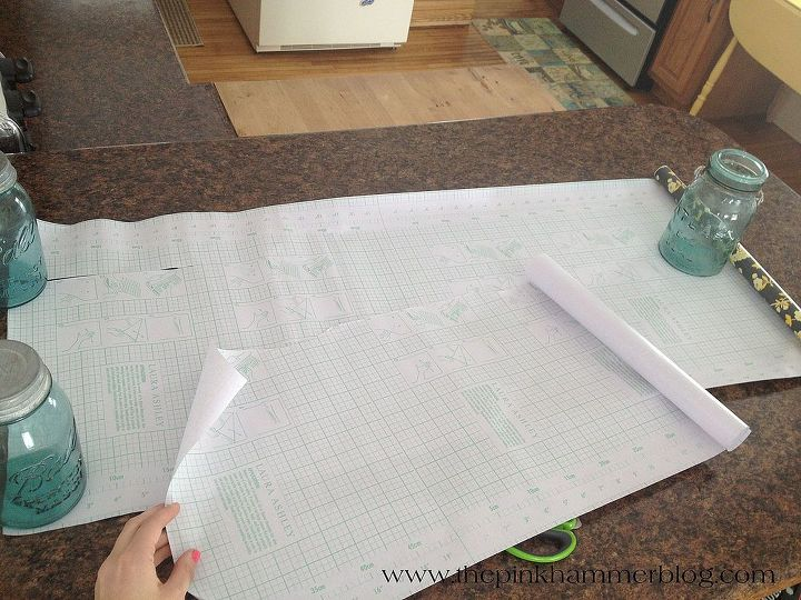 Cutting the shelf liner for the drawers