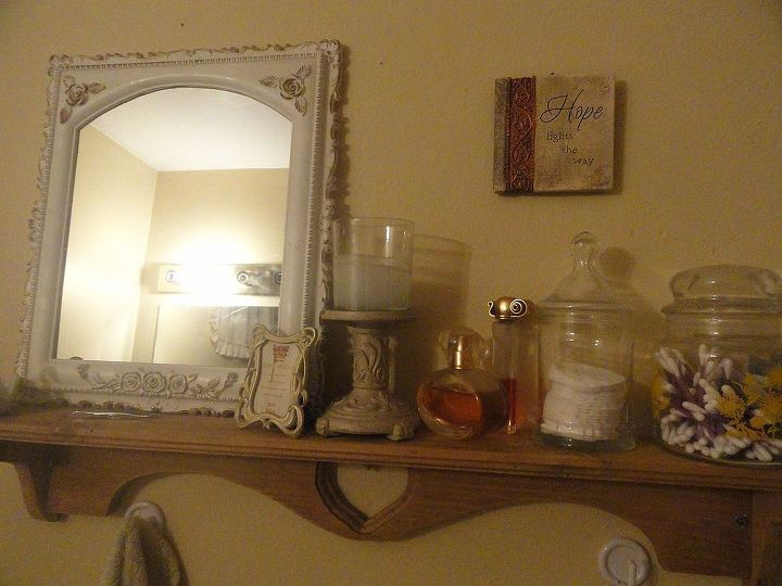 i found the shelf at a thrift store for about $1. the mirror was a picture frame i got for 50 cents. i bought a mirror from the dollar tree and replaced it.