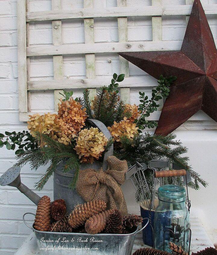 Winter potting sink ~ fresh greens, galvanized and dried hydrangea blooms. http://pinterest.com/barbrosen/