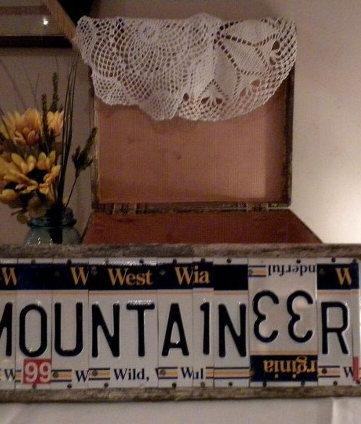 Gift table vignette:  vintage suitcase for cards, sign fashioned of barn wood & old license plates