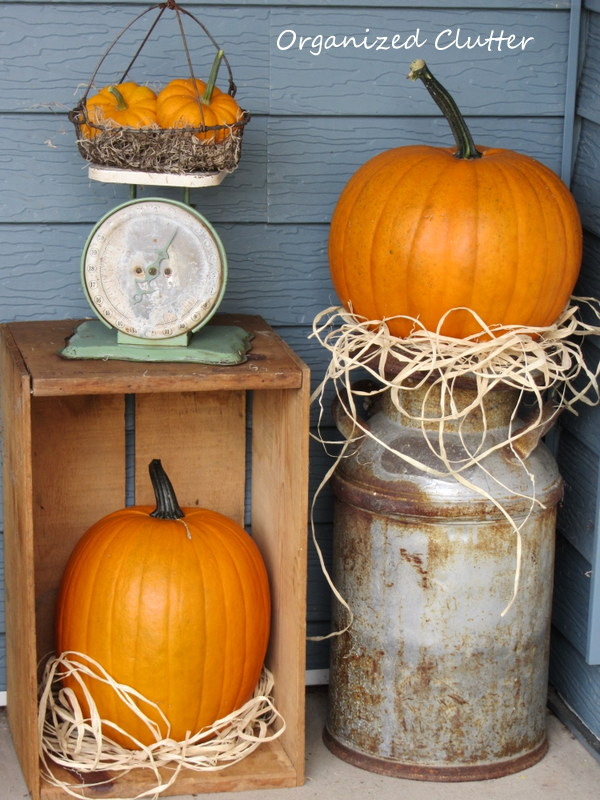 The front step with more pumpkins and vintage decor.