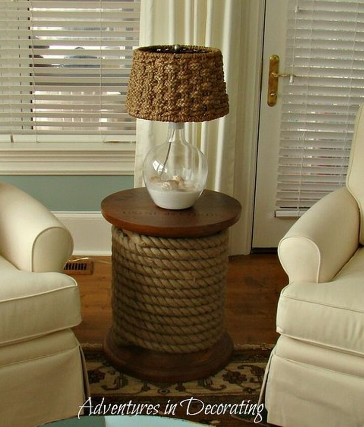 Fun spool table from Ballards paired with a fun, glass lamp from Pottery Barn.  I chose four of these comfy, swivel rockers from Capri Furniture.