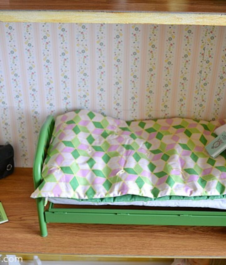 Scrapbook paper becomes wallpaper for the bedroom.