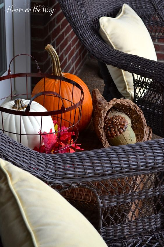 I love using a coffee table on the porch because it allows me to fill the space with objects that can add some height and depth to the porch.
