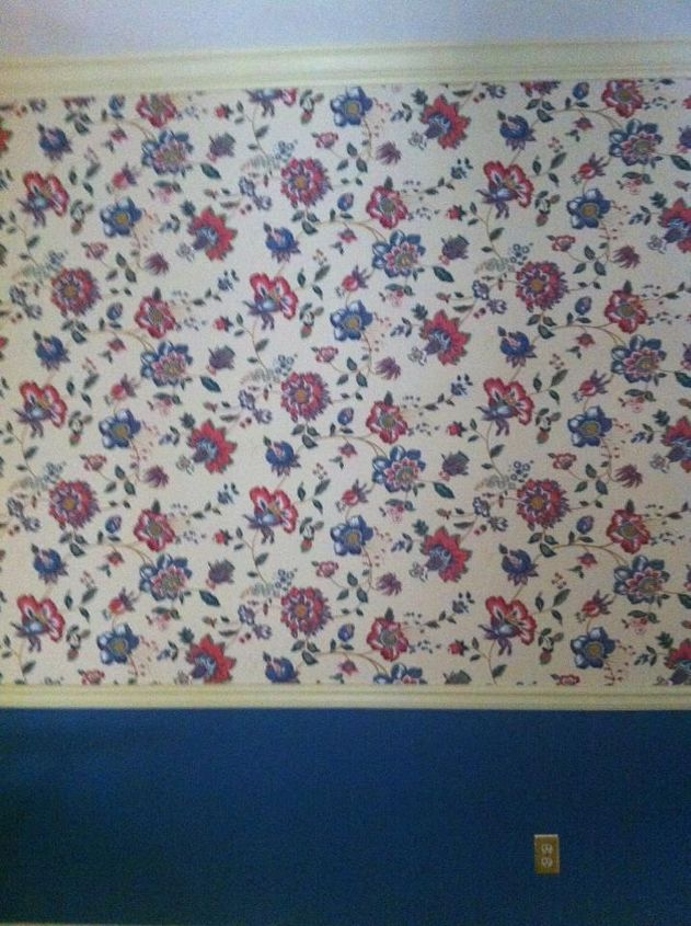 We started with this - 80's flowered wall paper with chair rail and a lower blue paint color in the original dining room.