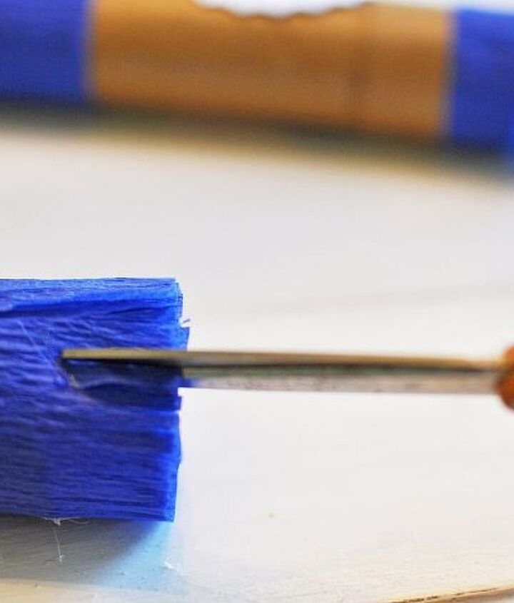 small cuts in the crepe paper results in cute fringe, stop by for more instructions.