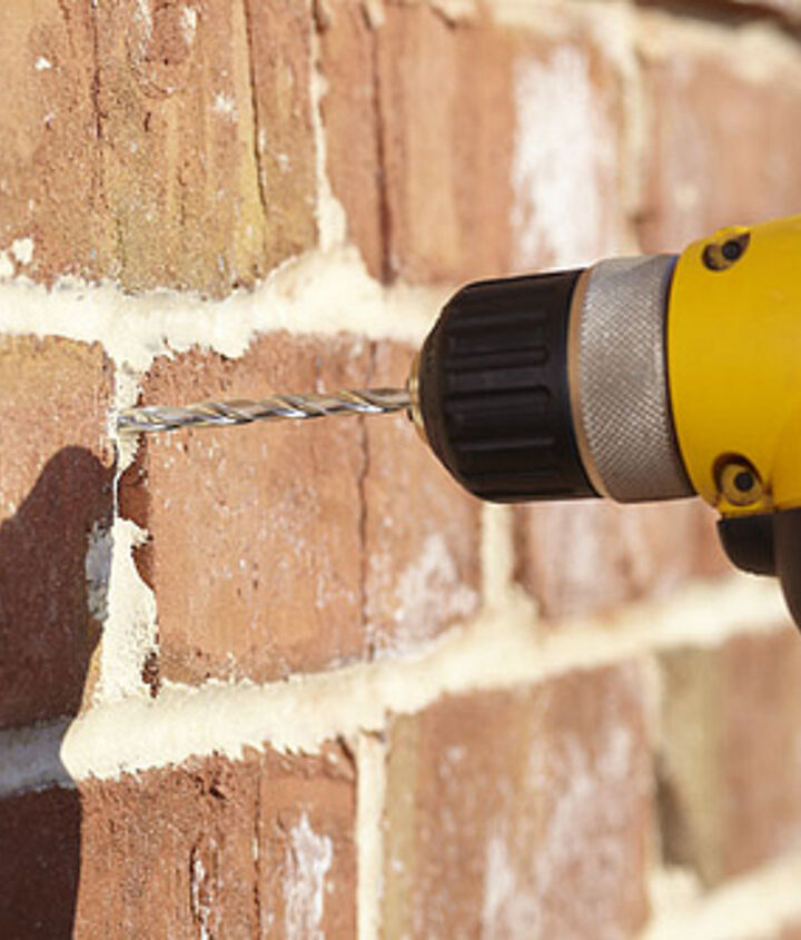 Drilling into mortar is safer and more easily repairable if you make a mistake.