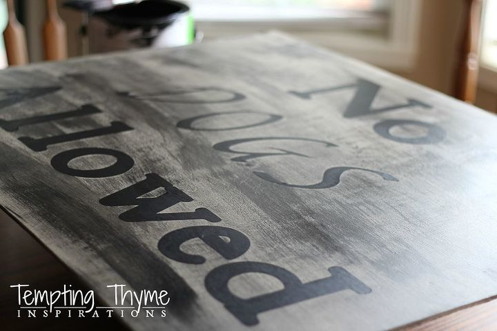 I dry brushed black paint over the letters and peeled up the vinyl letters.
