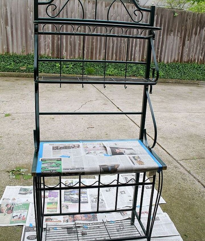 I bought a used standard green baker's rack, and spray painted it black.