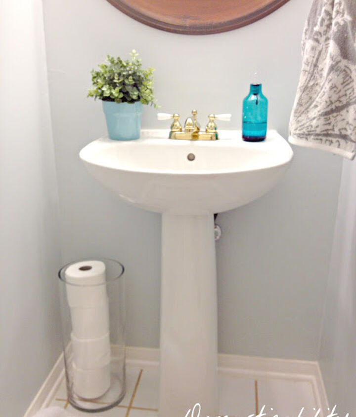 Use a tall cylinder vase to store toilet paper.
