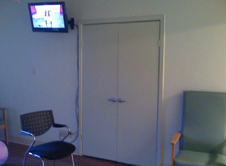 This supply closet was the center of attention with a little TV mounted above...