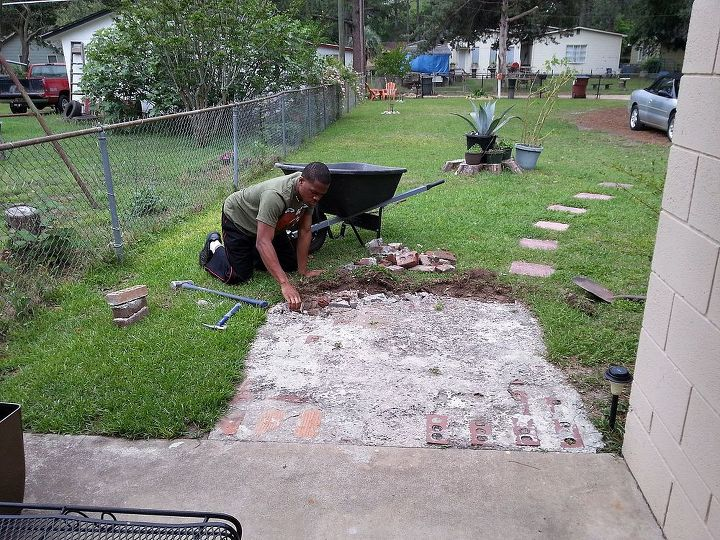 My son removing it.  Repurposed  broken bricks and concrete into a border around flowerbeds