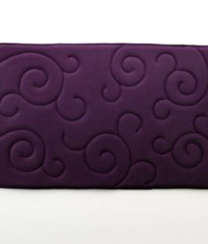 Purple Accents: Rugs are a great way to add color and comfort. Mohawk Home scroll memory foam bath rug