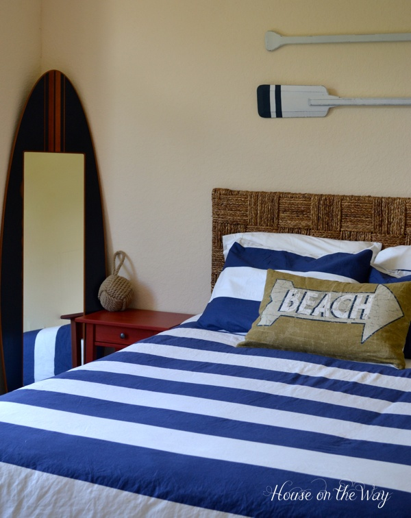create a beach theme bedroom, bedroom ideas, home decor, A great beach boy bedroom has some classic touches like seagrass jute burlap navy and white stripes and of course a surfboard
