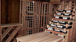 q we drink a lot and need help making this cabinet into a bar any ideas, diy, kitchen cabinets, This is a hand made wine rack in a climate controlled basement This is well beyond the scope of what you need But if you notice to the bottom far left a simple design that can fit inside of your cabinet