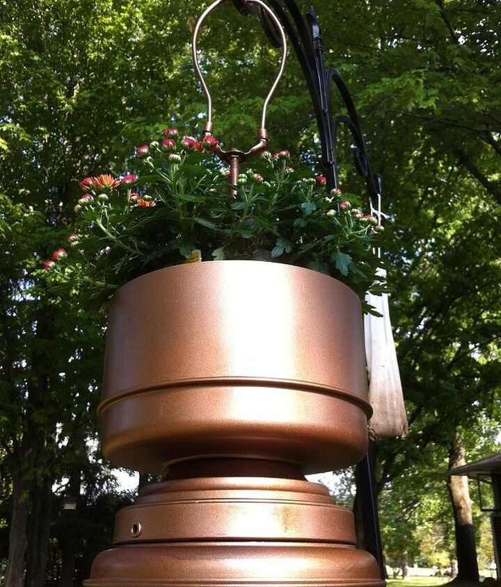 The trick was to find a flower basket that was just tall or short enough to fit inside without seeing a large portion of the pot.