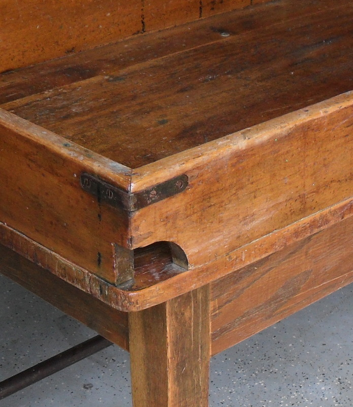 q does anyone have any information value about this postal table, painted furniture, The front 2 corners have this hole