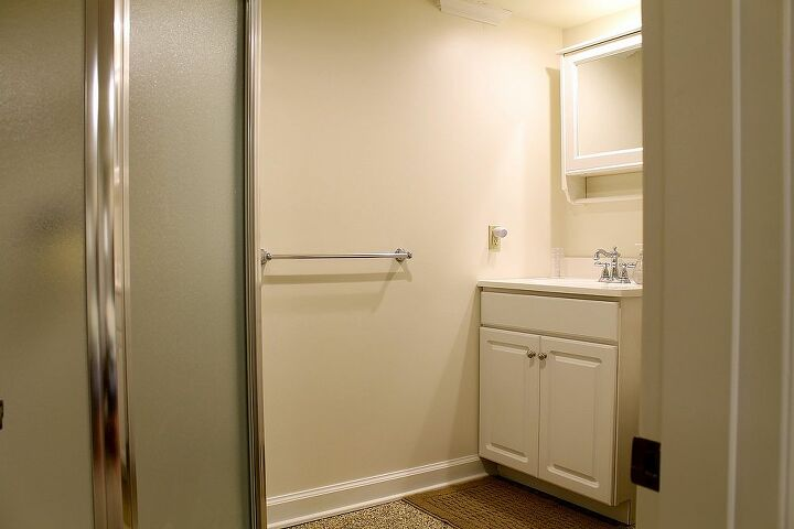 q i need decorating advice for this bathroom, bathroom ideas, home decor, The room is basic white with a shower stall