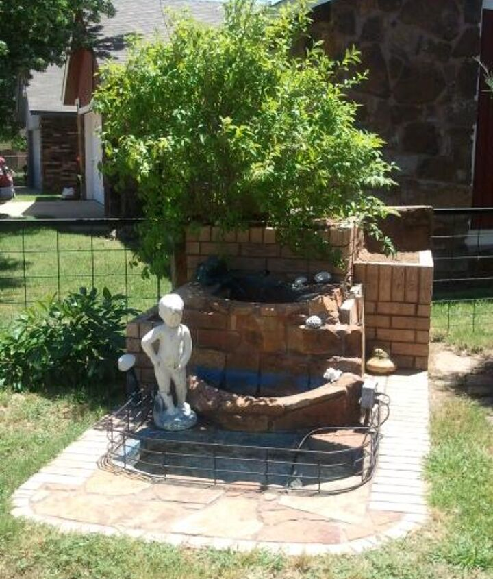 My fountain that I am working on. Need ideas for the right and left container beds.