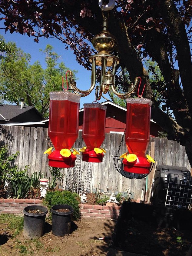 Diy humming bird feeder hanger made from left over hardware  from top of hanging lamp