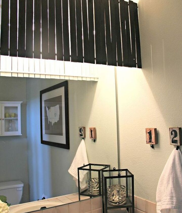 """I created a wood shim light cover to hide the oh so lovely """"hollywood light fixture"""". It was the best $7.00 spent!!"""