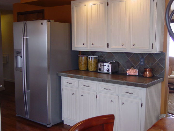 The fridge was once to the right of the cupboards, which stuck out into the dining area..We moved the fridge to the left and shoved the cabinets down to the right...makes it much roomier and brings the fridge closer to the cooking area.