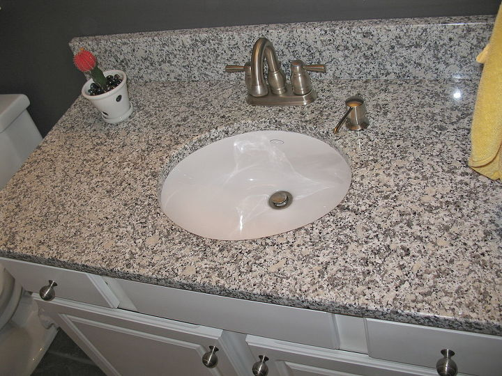 AFTER: New granite, faucet, soap dispenser and sink